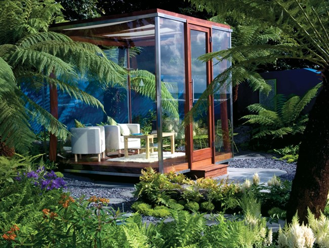 Designing a greenhouse as a tropical oasis wma property for Garden greenhouse design