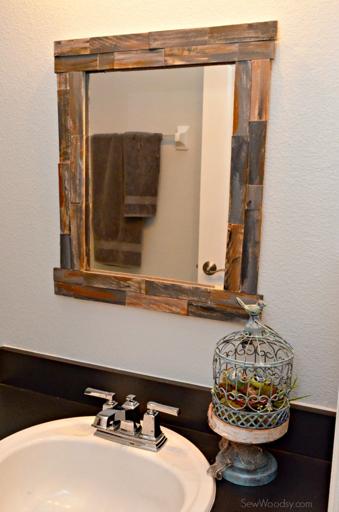8 ways to prettify bathroom without repacking wma property for How to frame my bathroom mirror